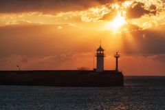 Lighthouse in Yalta at sunrise Stock Image