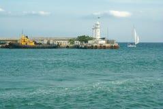 Lighthouse in Yalta, Ukraine. Mooring line near lighthouse in Yalta, Ukraine royalty free stock photo