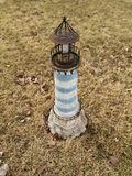 Lighthouse in yard royalty free stock images