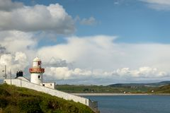 Lighthouse at Youghal port on bright sunny day Stock Photo