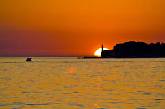 Lighthouse in Zadar epic sunset. Lighthouse in Zadar and boat on the sea epic sunset, Dalmatia, Croatia Royalty Free Stock Photo