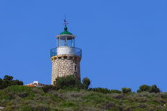 Lighthouse in Zakynthos Island, landmark attraction in Greece. Lighthouse on blue background in Zakynthos Island, landmark attraction in Greece Stock Photography