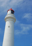 Lighthouse2. White lighthouse against blue sky Royalty Free Stock Photos