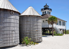 LighthouseAtBocaGrande. This is an image of the deactivated historic lighthouse at Boca Grande Pass in the Gulf of Mexico and two wooden cisterns that were used Stock Photo
