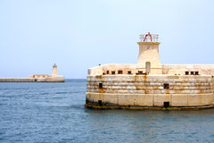 Lighthouses. At the entrance to Grand Harbour on Malta island Stock Photo
