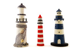 Lighthouses. Row with different lighthouses isolated over white royalty free stock photos