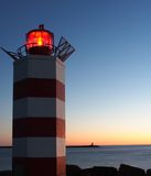 Lighthouses at dusk. Two lighthouses at dusk guarding the harbor entrance stock images