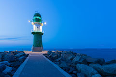 Lighthouses at Rostock-Warnemunde. Green lighthouse at the harbor entrance of Rostock Warnemunde Royalty Free Stock Photography