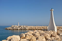 Lighthouses in summer day. Two lighthouses in village Zygi, Cyprus, Mediterranean sea stock image