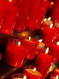 Lighting. Close up of candles in red candle holder Royalty Free Stock Photos