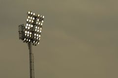 Lighting. Tower of artificial light in stadium Stock Photo