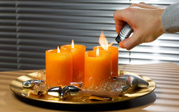 Lighting advent candles Stock Photo