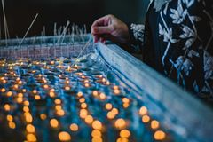 Lighting another candle Royalty Free Stock Photo