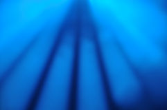 Lighting background. Abstract background formed by blue spotlighting at a live performance Stock Photography