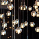Lighting balls on the chandelier in the lamplight,  light bulbs hanging from the ceiling, lamps on the dark background, selective. Focus, horizontal Stock Photography