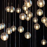 Lighting balls on the chandelier in the lamplight,  light bulbs hanging from the ceiling, lamps on the dark background, selective. Lighting balls on the Royalty Free Stock Photography