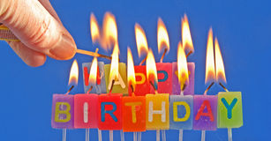 Lighting birthday candles. Stock Photo