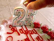 Lighting Birthday Candles Royalty Free Stock Photography