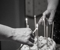 Lighting birthday candles Stock Images