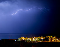 Lighting bolt in seaside city Royalty Free Stock Images