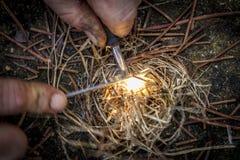Lighting a bonfire stock photo