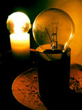 Lighting bulb. Two old bulbs in dark room, one is shining stock photography