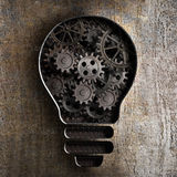 Lighting bulb business concept with working gears and cogs Royalty Free Stock Image
