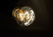 Lighting bulb. In the dark Royalty Free Stock Photo