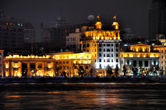 Lighting business building of Shanghai Bund, China. Night view of Shanghai Bund historical and morden business buildings, beside Huang-pu river, shown as Royalty Free Stock Photos
