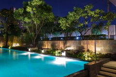 Lighting business for luxury backyard swimming pool. Relaxed li