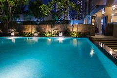 Lighting business for luxury backyard swimming pool. Relaxed li. Festyle with contemporary design by professionals stock images