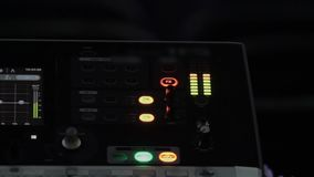 Lighting buttons on sound equipment at broadcasting studio, electronics. Stock footage stock video footage