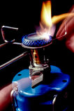 Lighting a camp stove Stock Photos