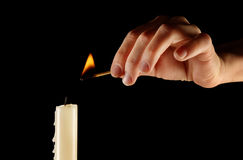 Lighting a candle Royalty Free Stock Photo
