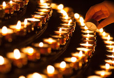Lighting a candle Stock Photos
