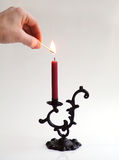 Lighting the candle Stock Photos