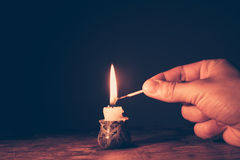Lighting a candle Stock Photo