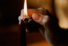 Lighting a candle. Image of a candle being lit royalty free stock photography