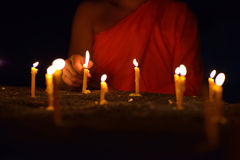 Lighting candle of buddhism Stock Images