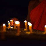 Lighting candle of buddhism Stock Image