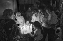 14. Lighting a  Candle in the Church of Holy Sepulchre. Lighting  Candle in the Church of Holy Sepulchre Royalty Free Stock Photos
