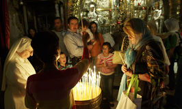 Lighting a  Candle in the Church of Holy Sepulchre Stock Photo
