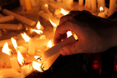 Lighting a Candle Royalty Free Stock Image