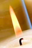 Lighting candle with match Stock Photo