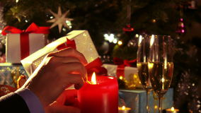 Lighting candle with matches in front of the Christmas tree 4 k stock video footage