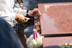 Lighting Candle over The Grave in The Annual Blessing of Graves at Ratchaburi Province, Thailand Stock Photos