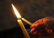 Lighting the candle for pray. And make a wish Royalty Free Stock Photos