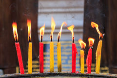 Lighting candle of the prayers at the temple Stock Photography