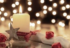 A lighting candle with roses stock photos