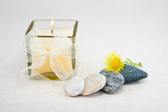 Lighting candle with stones Stock Photo